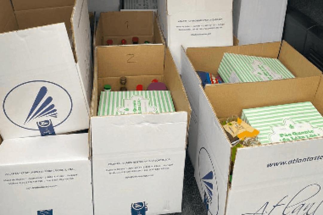Colaboradores da Atlanta distribuem cabazes de Natal a famílias carenciadas.